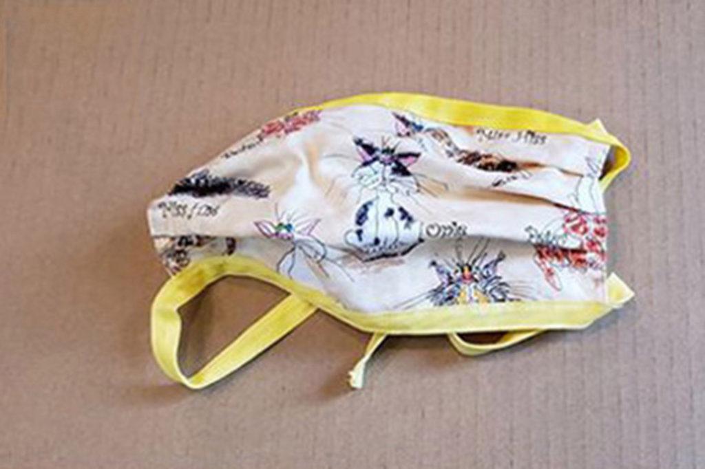Dubbelgelaagd katoenen masker met linten